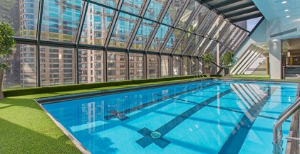 The indoor pool under wall of windows in Axis Apartments in Streeterville Chicago
