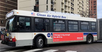 A Chicago CTA bus with Domu's 2018 ad that talks about being a nice neighbor