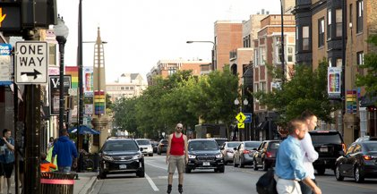 man rollerblading on N Halsted St in Boystown neighborhood of Chicago, IL