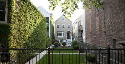 workers cottage with front yard in Bucktown neighborhood of Chicago