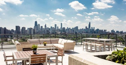 view of downtown Chicago and the skyline from rooftop deck at the north tower of Lincoln Common apartments