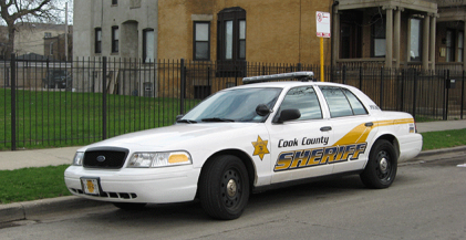 Cook County Sheriff's car delivering eviction notices