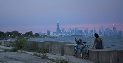 Chicago skyline at dusk viewed from beach in Hyde Park neighborhood