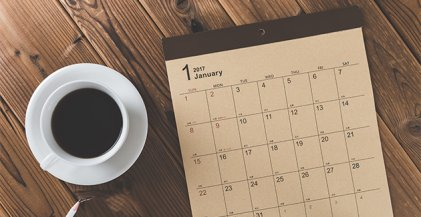 coffee cup and planning calendar for renting apartment