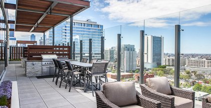 outdoor bbq area of River North apartment building with view looking at downtown Chicago