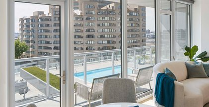 apartment for rent at The Cooper at Southbank with balcony overlooking apartment building pool and neighboring River City Apartments