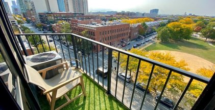 leaves turning colors in the fall seen from a Chicago apartment balcony