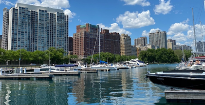 boats docked at Belmont Harbor in Chicago with apartment buildings in background