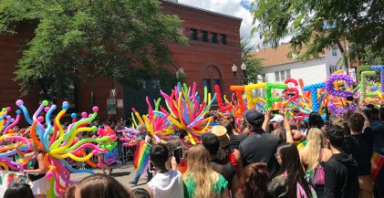 festival guests line the street at Chicago Pride Parade on North Halsted St