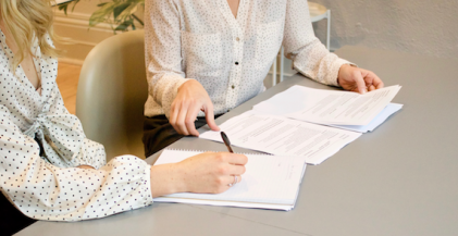 two people negotiating terms of an apartment lease agreement