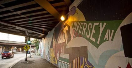 mural underneath I-90/94 expressway with Chicago street signs