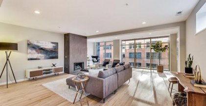 furnished living room with grey sofa in front of fireplace in Chicago apartment for rent
