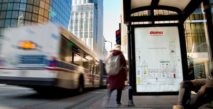 bus shelter on N Fairbanks Ct in Chicago displaying a 2019 Domu advertisement
