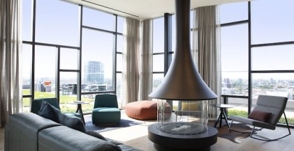 amenity space in West Loop, Chicago apartment building with communal seating and fireplace