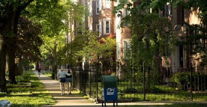 roommates walking on a sidewalk near Rogers Park Chicago apartment bulidings