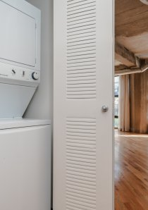 stacked washer and dryer in Chicago apartment for rent