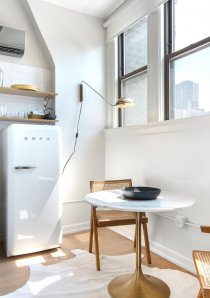 a studio apartment for rent in Chicago with bistro dining table next to kitchen