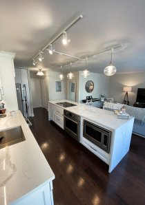 kitchen island with white marble countertops in Chicago apartment for rent