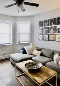 grey sofa in living room of short term rental apartment in Chicago