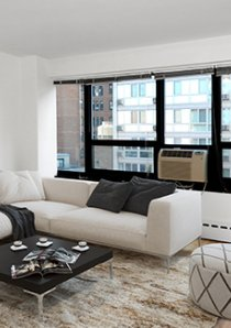 sectional sofa and windows in living room of 1 bedroom apartment for rent in Chicago