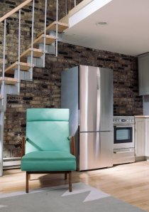 teal armchair beside staircase in studio apartment for rent in Chicago