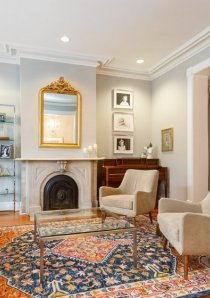 living room with fireplace and patterned rug in 4 bedroom apartment for rent in Chicago