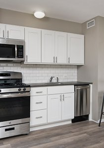 kitchen with bistro dining table and two metal stools in Hyde Park Chicago apartment for rent