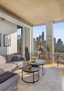 living room with grey sofa and fireplace in downtown Chicago apartment for rent