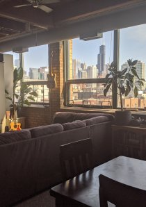 living room of Chicago 1 bedroom apartment with view of downtown city skyline from large windows