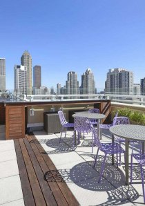 apartment rooftop patio with views of the downtown Chicago skyline