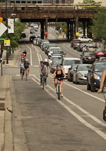 cyclists riding in bike lanes in Chicago Fulton Market neighborhood