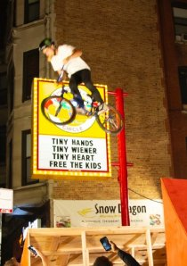 BMX pro Bryce Tryon jumps a ramp set up in front of The Wiener's Circle in Lincoln Park, Chicago