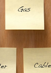 yellow sticky notes with reminders about utility bills written on them