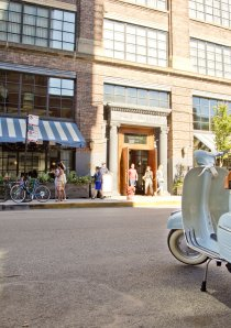 a vintage Vespa scooter parked outside a restaurant in Chicago