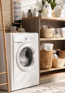 modern washing machine in apartment laundry room