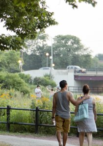 a couple walking in Humboldt Park in Chicago