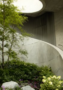 a winding concrete staircase below apartments in Lakeshore East neighborhood of Chicago