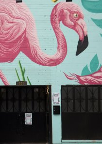 mural of pink flamingo painted on Flamingo Rum Club in River North, Chicago