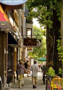 couple walking down sidewalk in Roscoe Village Chicago
