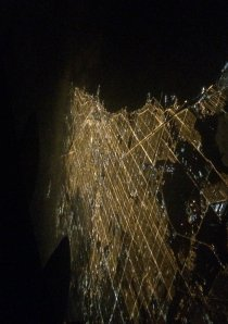 an aerial shot taken above Chicago at night showing the city traffic grid system