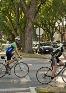cyclists at intersection in Budlong Woods neighborhood of Chicago