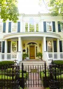 house for rent in Chicago with white porch and green trees
