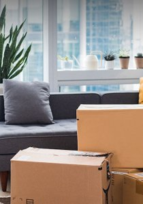 brown cardboard moving boxes in an apartment living room