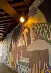 a mural depicting Chicago street signs painted in a viaduct in Chicago