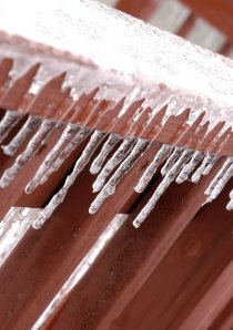 ice covering a banister on a Chicago apartment's outdoor porch