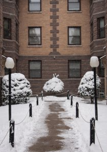 snow in a Chicago apartment building courtyard