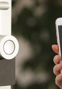 an apartment renter using a smartphone to open a smart lock for their Chicago apartment