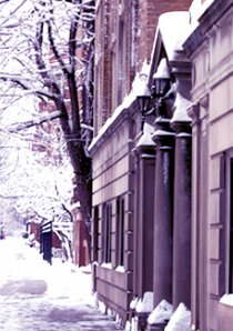 a snow covered sidewalk outside of a Chicago apartment building