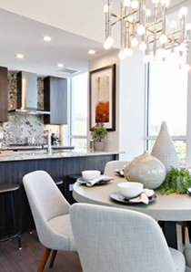 dining area and kitchen with marble waterfall counters in luxury apartment for rent in River North, Chicago