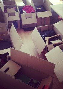 packed up moving boxes scattered on the floor in an apartment